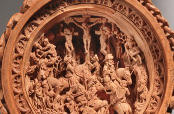 This tiny 16th-century rosary bead has 5 scenes from the Bible carved into it
